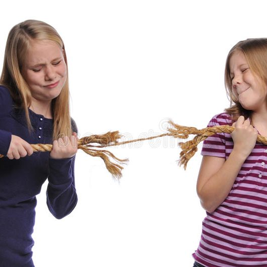 two-girls-fighting-over-rope-12956734